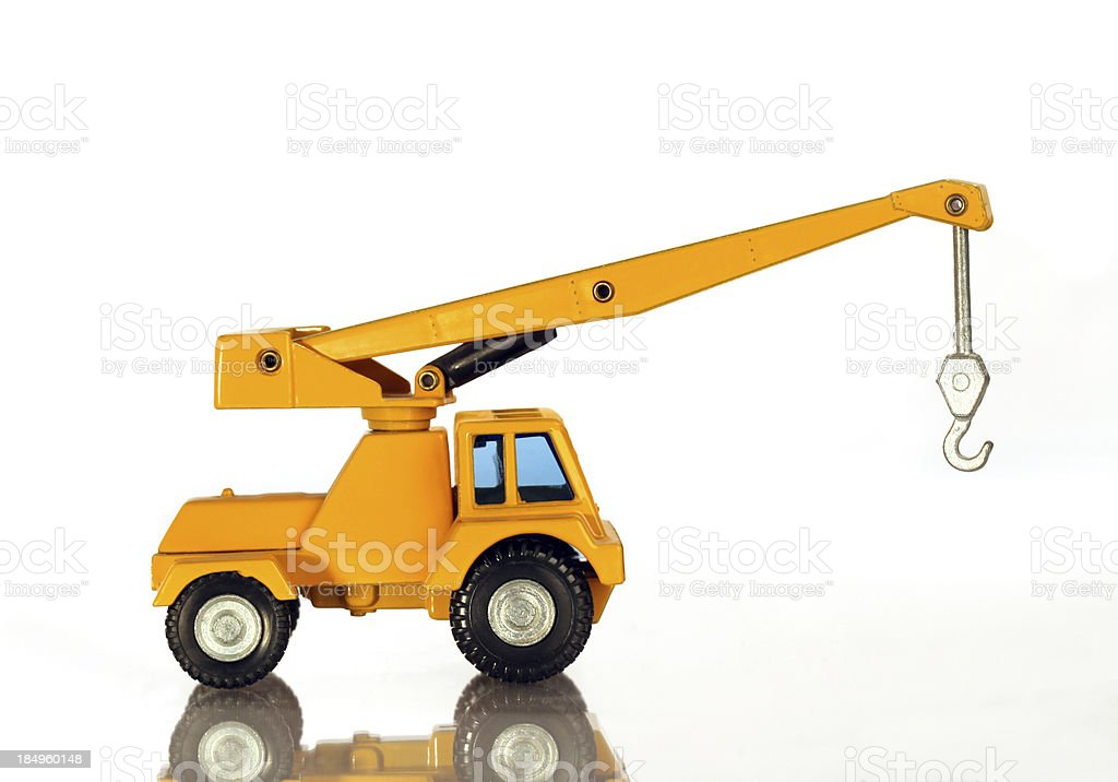 Yellow construction crane.  Model.  Isolated on white.  Boom up. stock photo