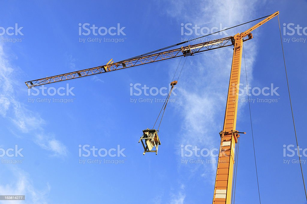 Yellow construction crane royalty-free stock photo