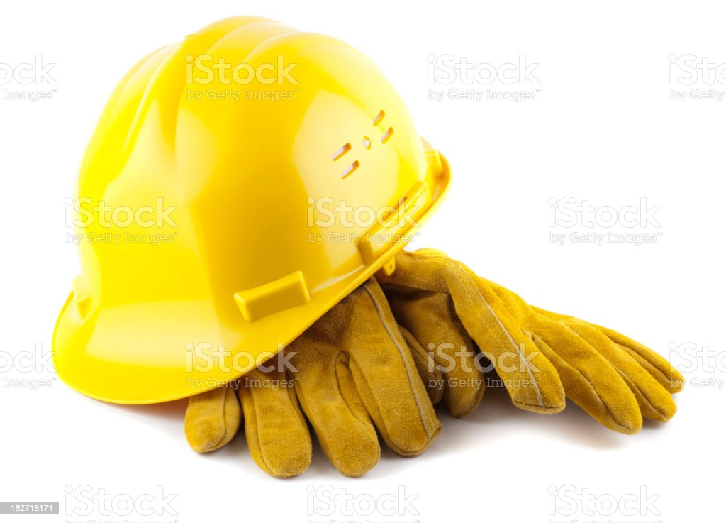 Yellow construction helmet and gloves isolated on white stock photo