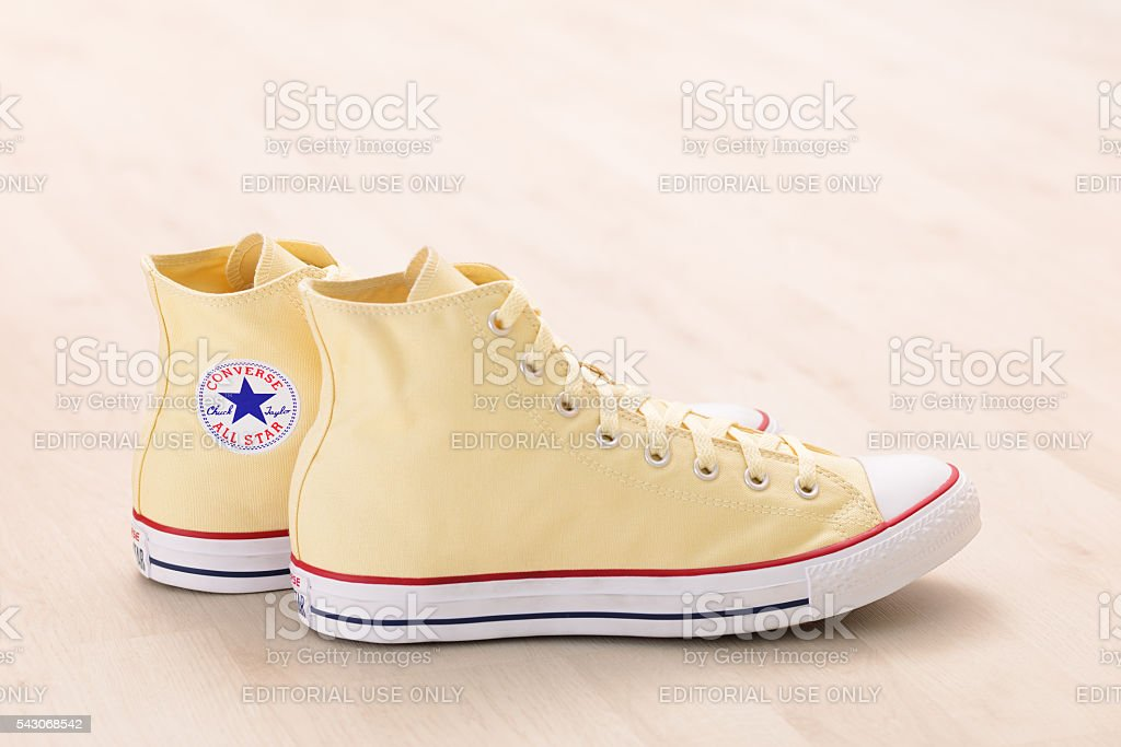 Yellow Converse sneakers stock photo