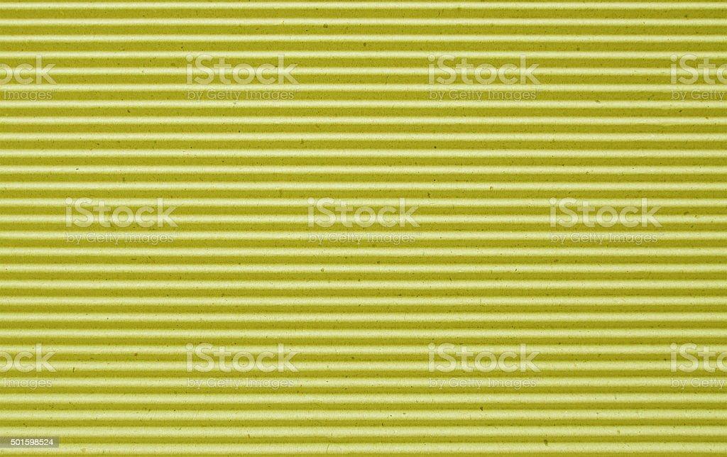yellow corrugated paper background. stock photo