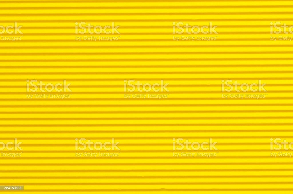 yellow corrugated paper background texture stock photo