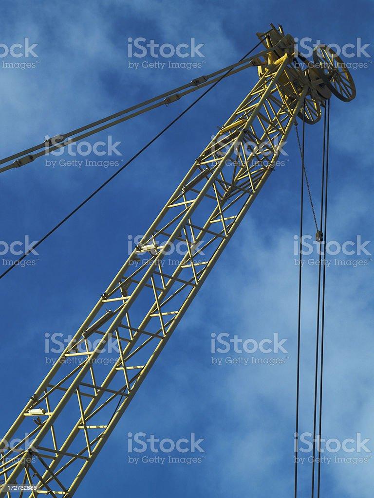 Yellow crane boom stock photo