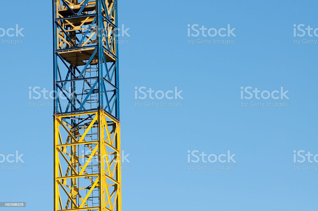 yellow crane ladder and blue sky royalty-free stock photo