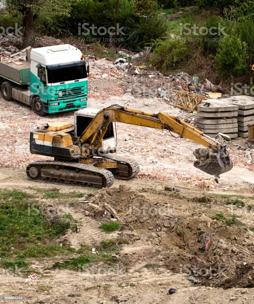 yellow crawler excavator machine on the construction site stock photo