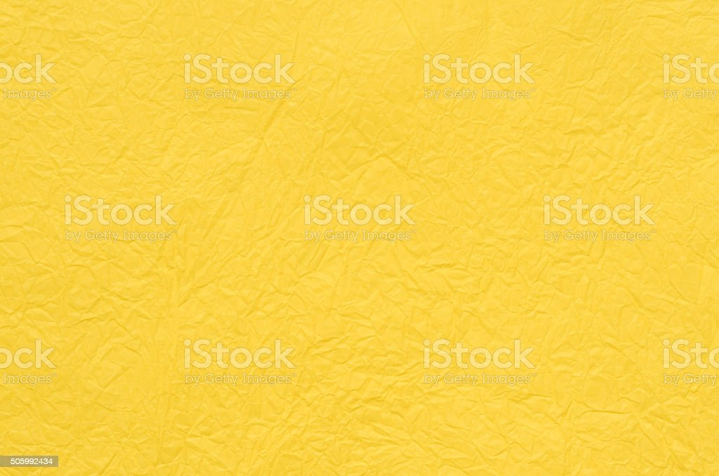yellow creased tissue paper background stock photo