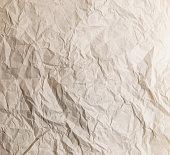 Yellow crumpled newspaper Texture