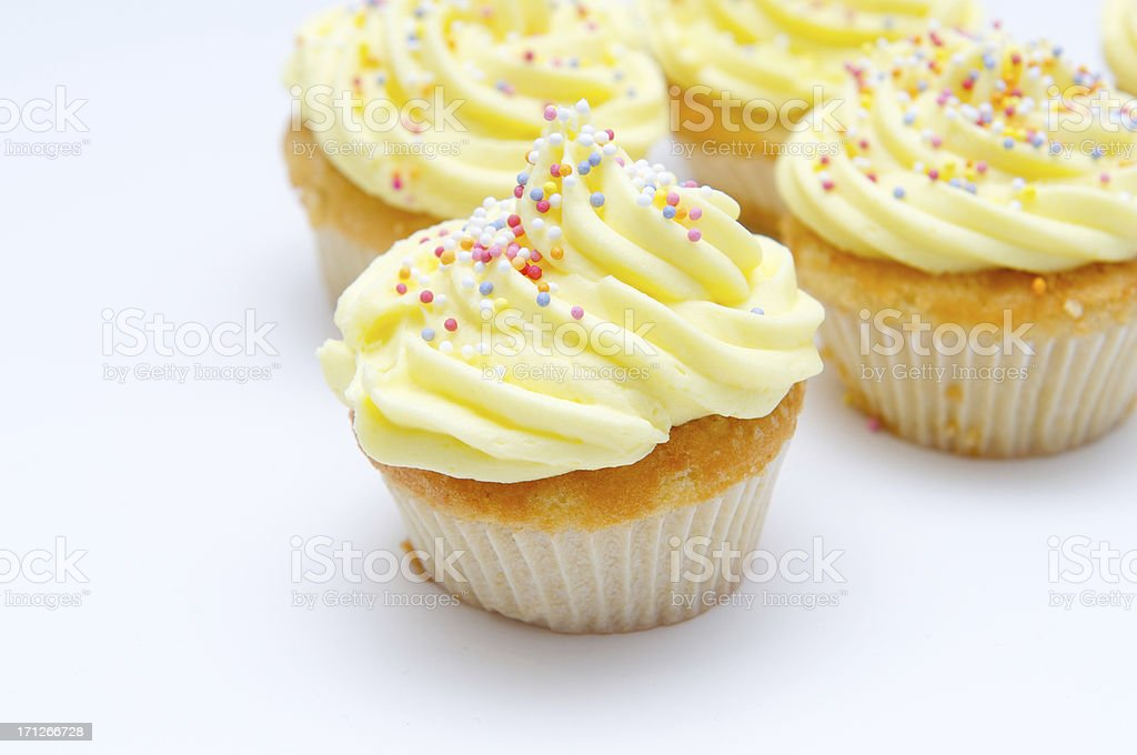 Yellow cup cakes stock photo