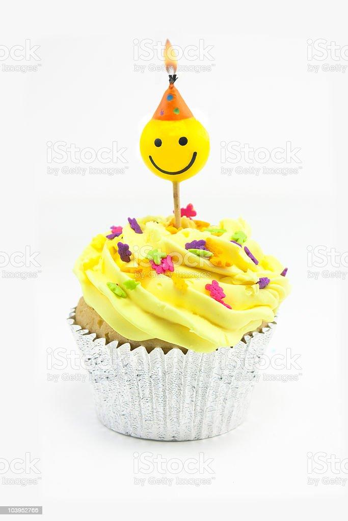 Gelb cupcake und smiley-Kerze Lizenzfreies stock-foto