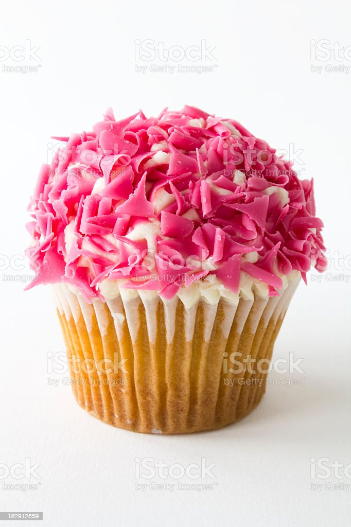 Yellow cupcake with stylish pink and white icing  royalty-free stock photo