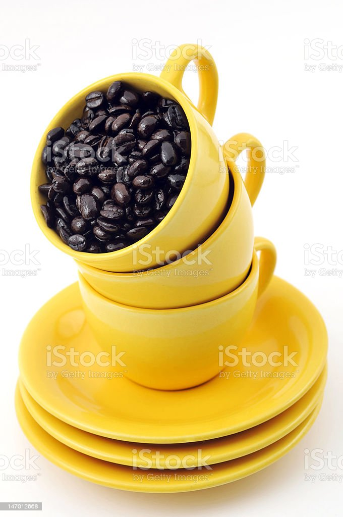 Yellow cups with coffe beans stock photo
