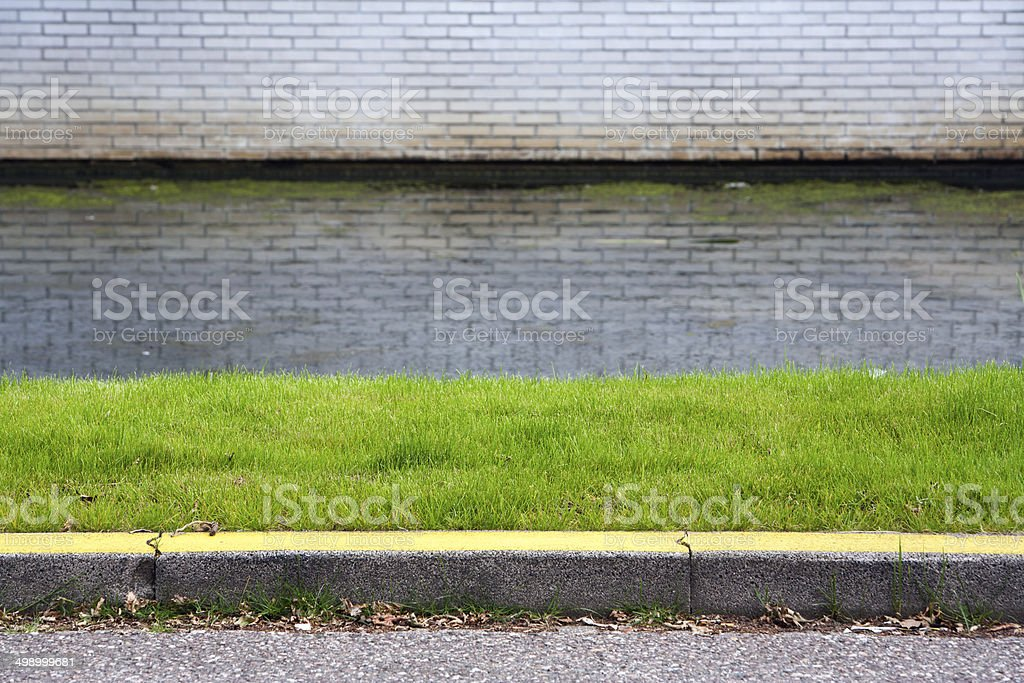 Yellow curb stock photo