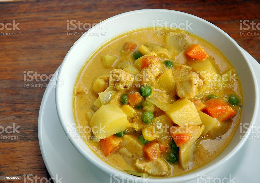Yellow curry in a bowl with meat and vegetables stock photo