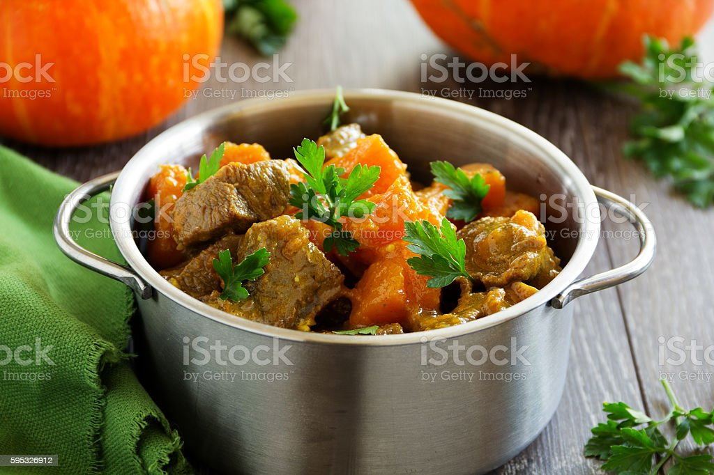 Yellow curry with pumpkin and pork. stock photo