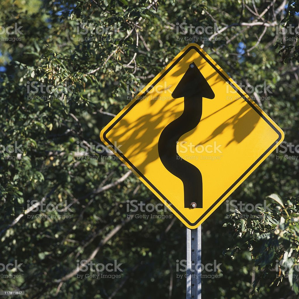 Yellow curve in the road sign royalty-free stock photo
