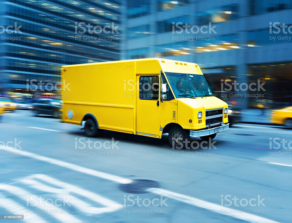 Yellow delivery truck in Manhattan stock photo