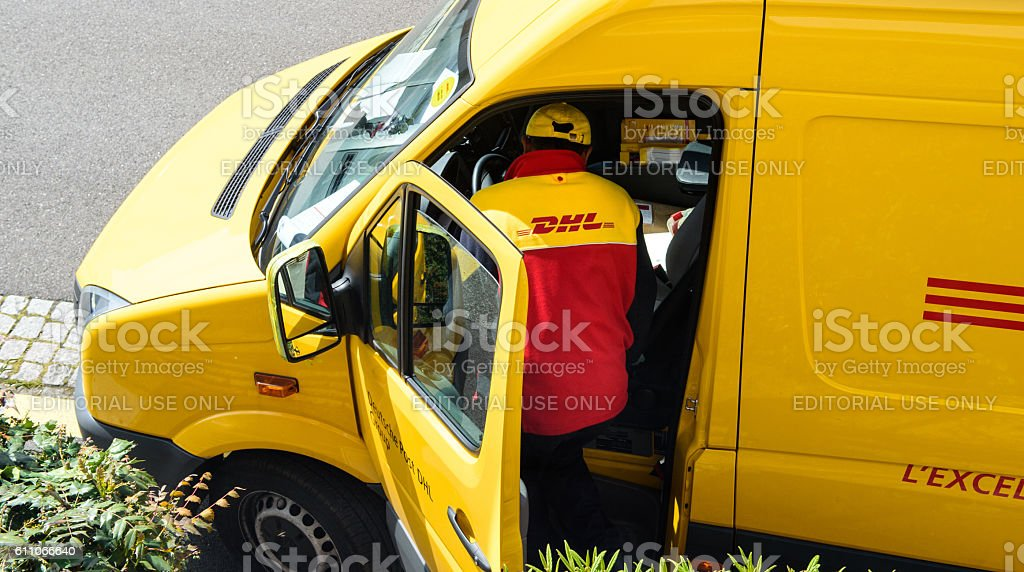 DHL yellow delivery van driver above stock photo