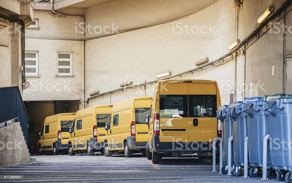 Yellow delivery vans trucks distribution stock photo