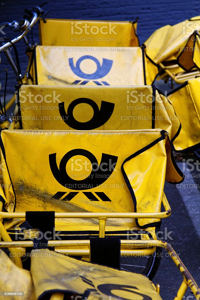 yellow Deutsche Post mail bags stock photo