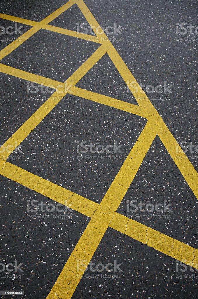 Yellow Diagonals on Asphalt royalty-free stock photo