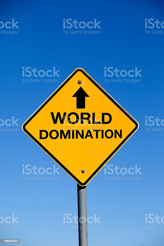 Yellow diamond sign with world domination on it stock photo