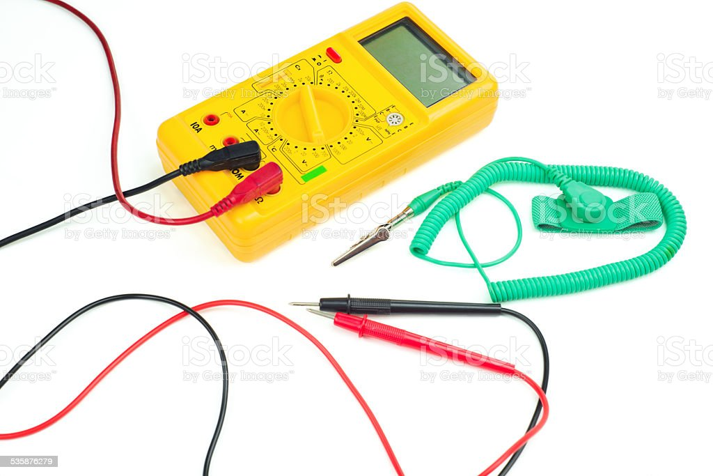 Yellow digital clamp meter and antistatic wrist strap stock photo