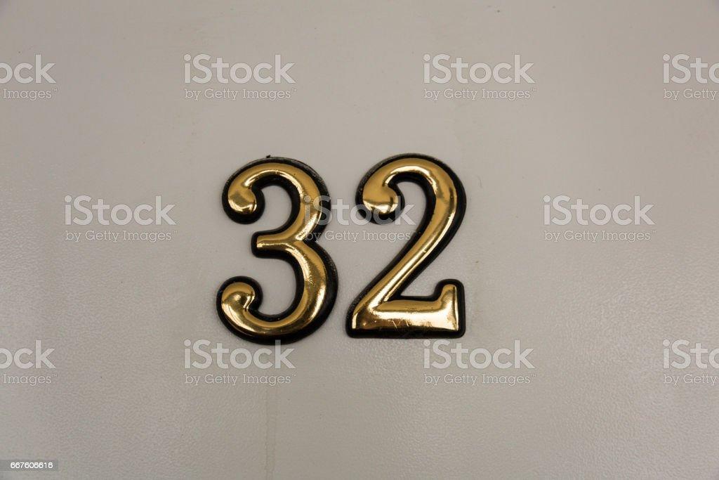 Yellow digits on the door stock photo