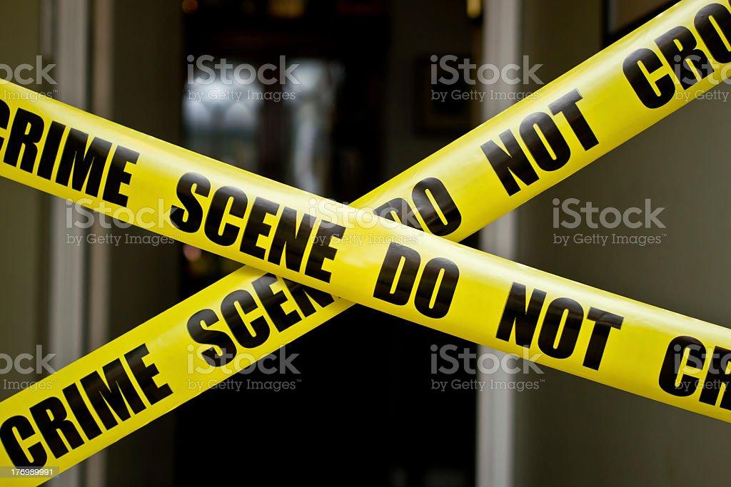 Yellow DO NOT CROSS CRIME SCENE tape stock photo