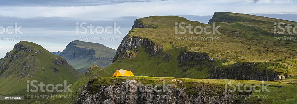 Yellow dome tent in dramatic mountain wilderness Highlands Scotland royalty-free stock photo