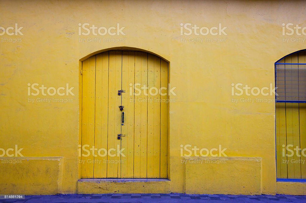 Yellow door and wall in Granada, Nicaragua stock photo