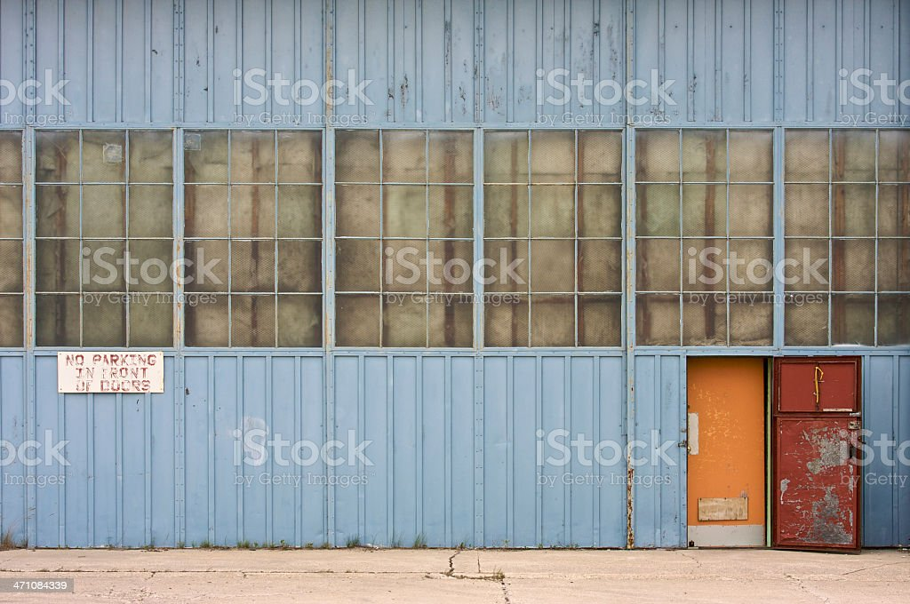 Yellow door in airport hangar. stock photo