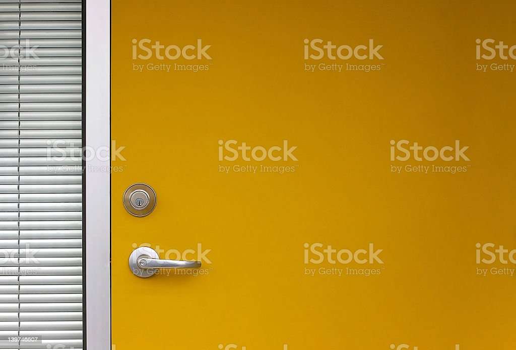Yellow door next to a blind curtain royalty-free stock photo