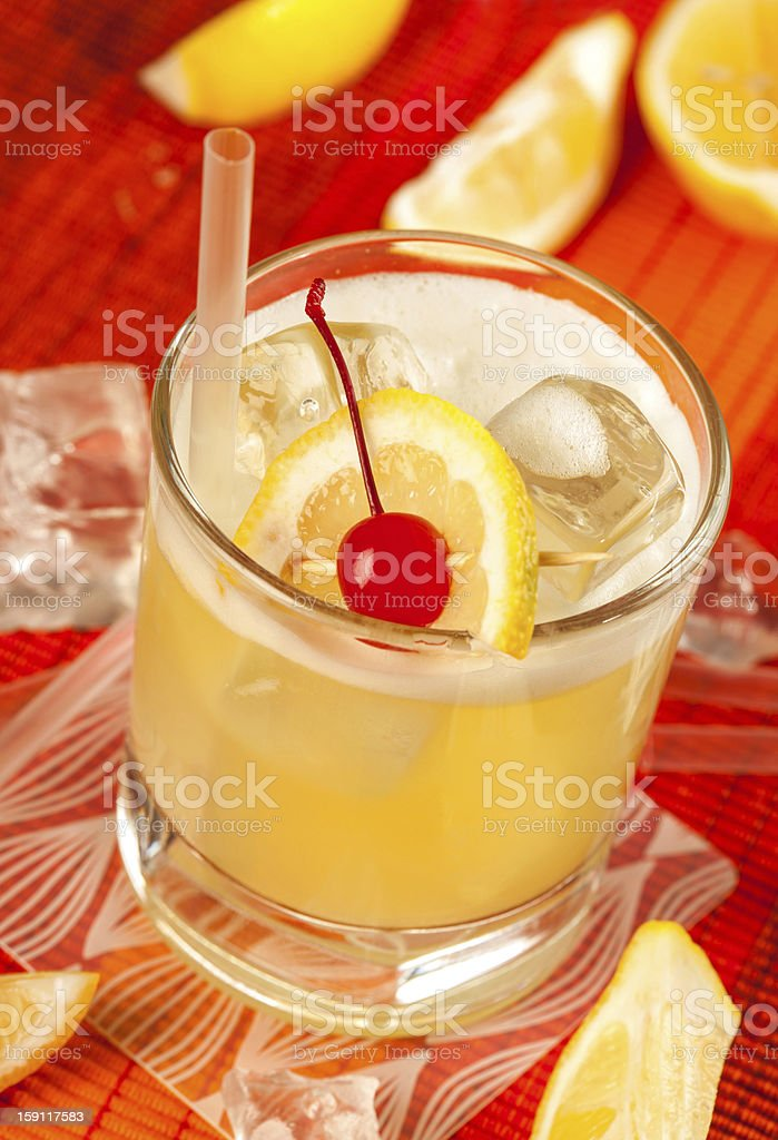 Yellow drink and ice royalty-free stock photo