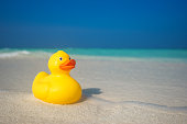 Yellow duck on the tropical beach. Concept travel and vacation