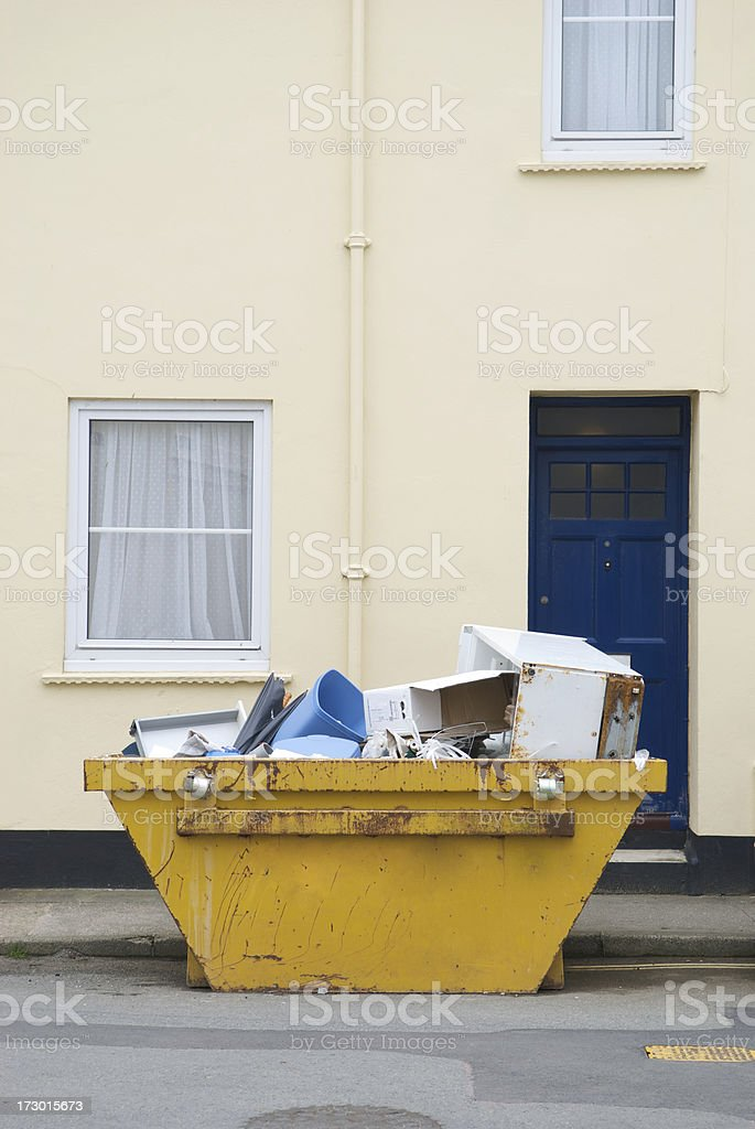 Yellow Dumpster Skip Bin Full of Garbage on the Street royalty-free stock photo