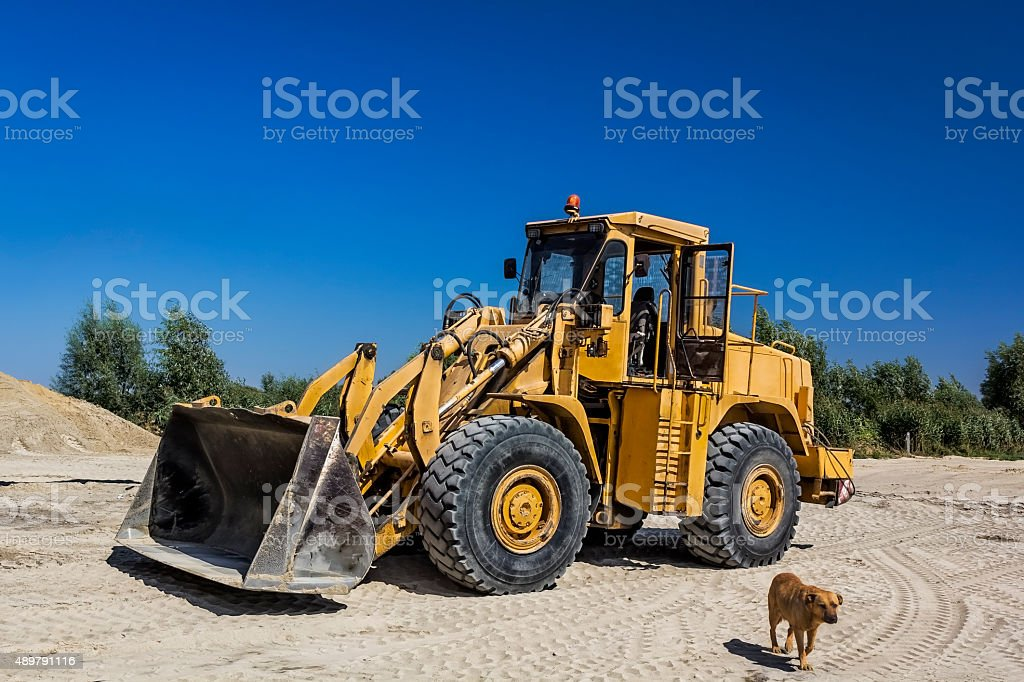 Yellow earth mover in Sand Quarry stock photo