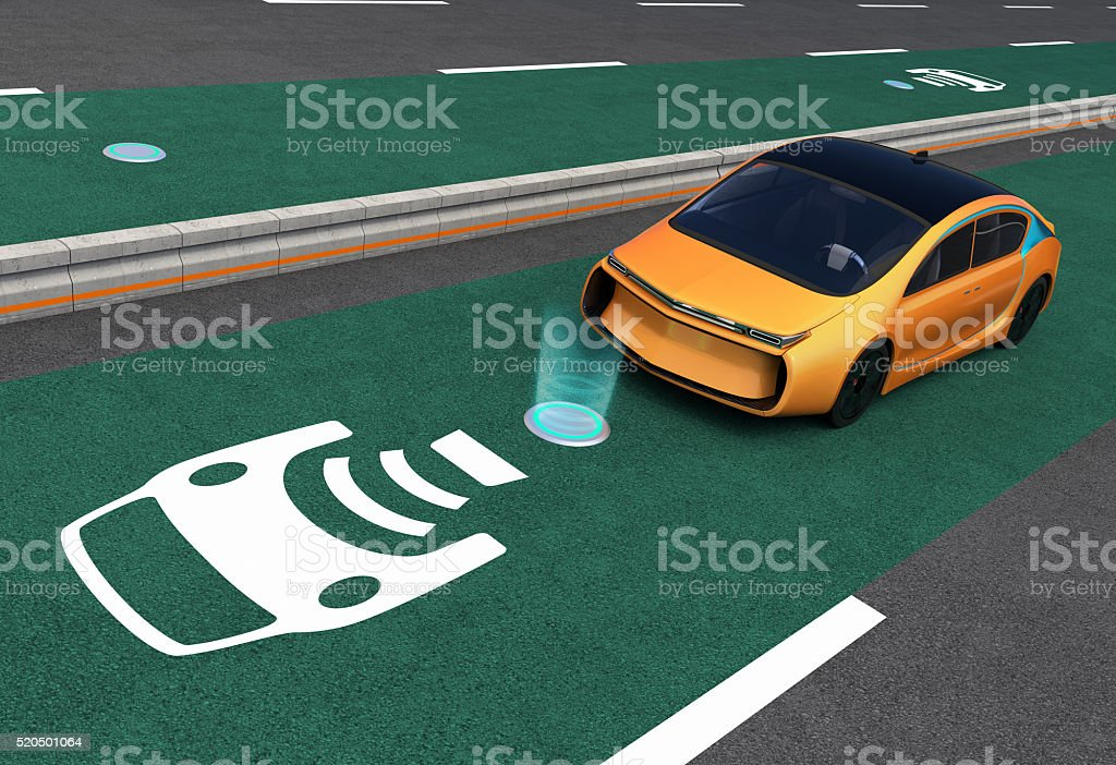 Yellow electric car on EV wireless charging lane stock photo