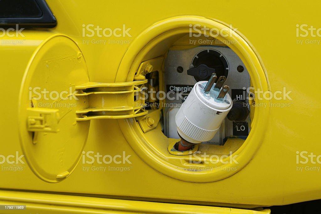 yellow electric vehicle plug stock photo