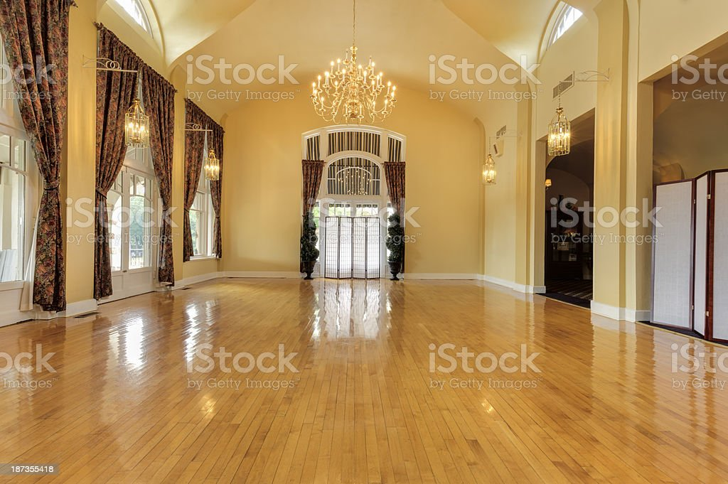 Yellow empty ballroom with high ceilings and chandelier stock photo