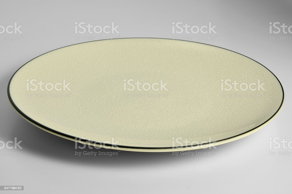 Yellow enamelled plate with chapped effect with black border stock photo