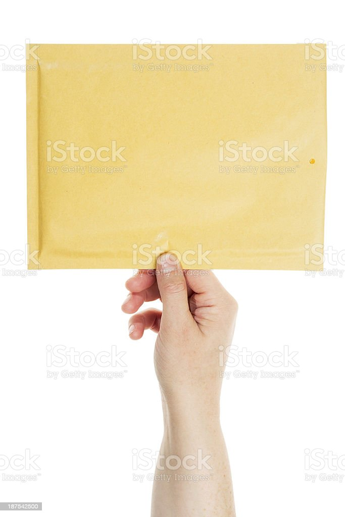 Yellow envelope in the hand royalty-free stock photo