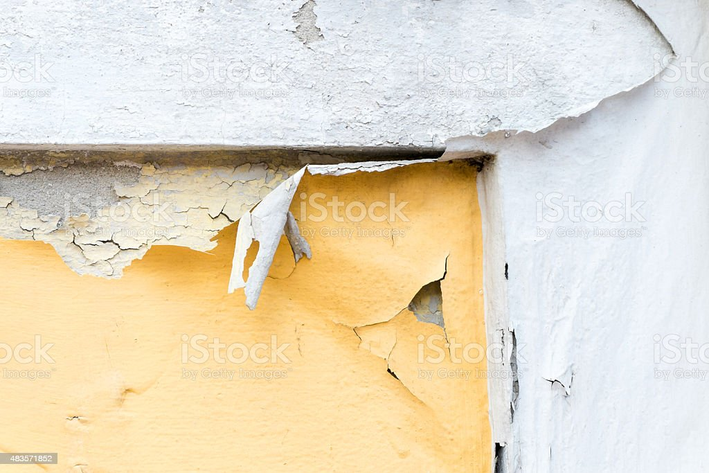 yellow erode painted concrete wall,grunge rough texture backgrou stock photo