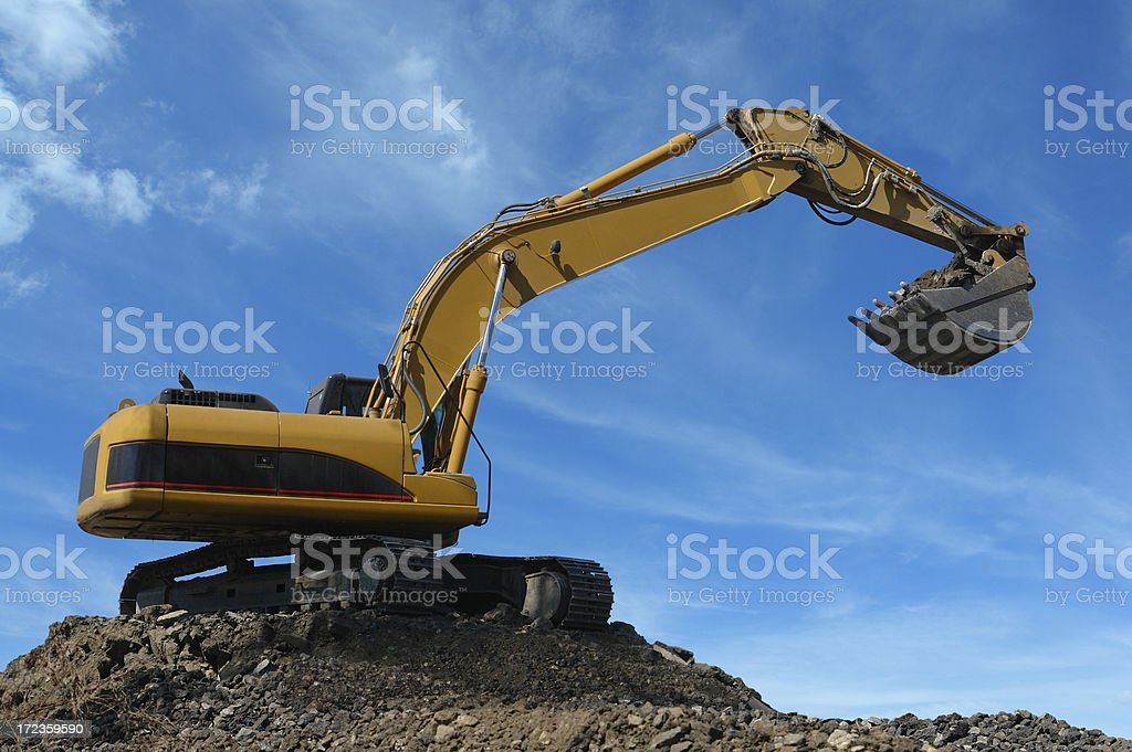 Yellow Excavator at Construction Site royalty-free stock photo