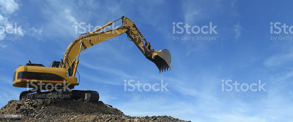 Yellow Excavator at Work stock photo