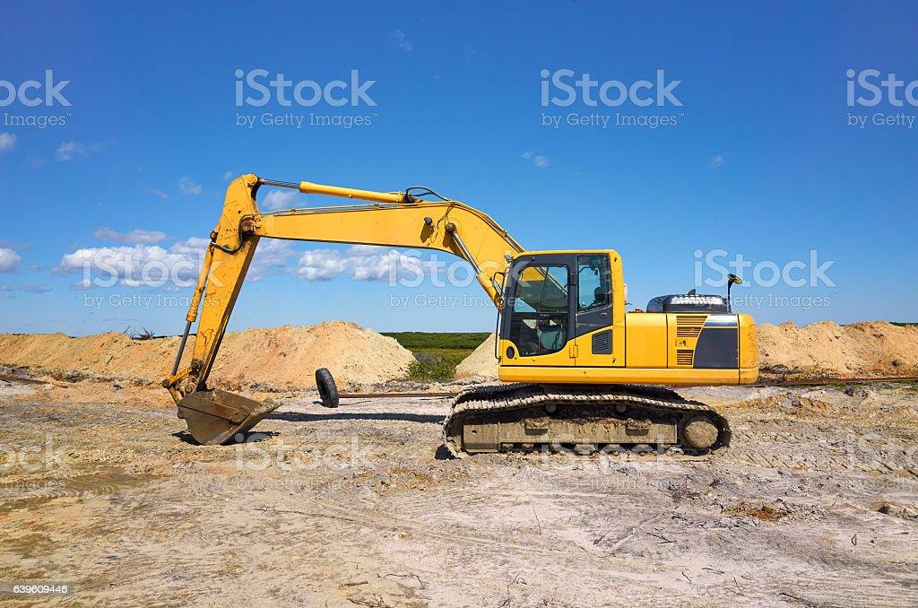 Yellow excavator digging stock photo