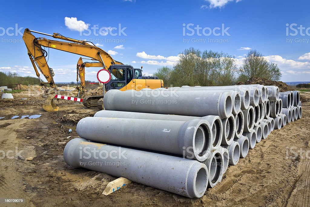 Yellow excavators in a new road construction royalty-free stock photo