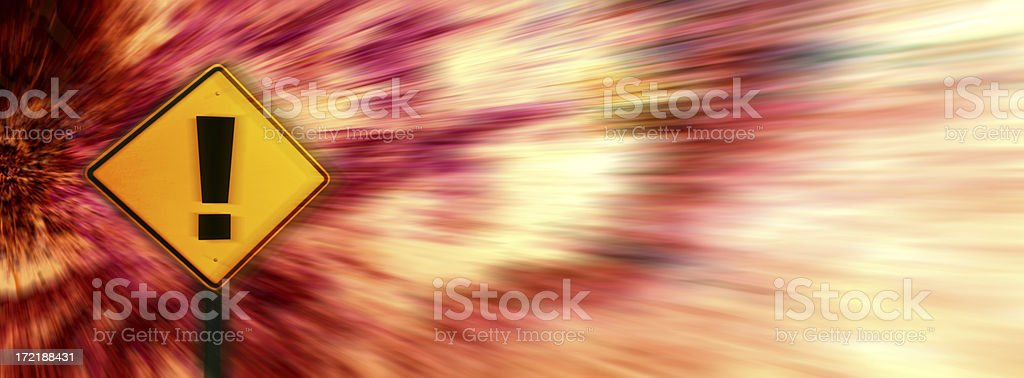 Yellow exclamation point warning sign on blurred background royalty-free stock photo