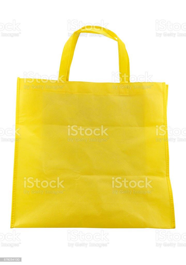 yellow fabric bag isolated on white background stock photo