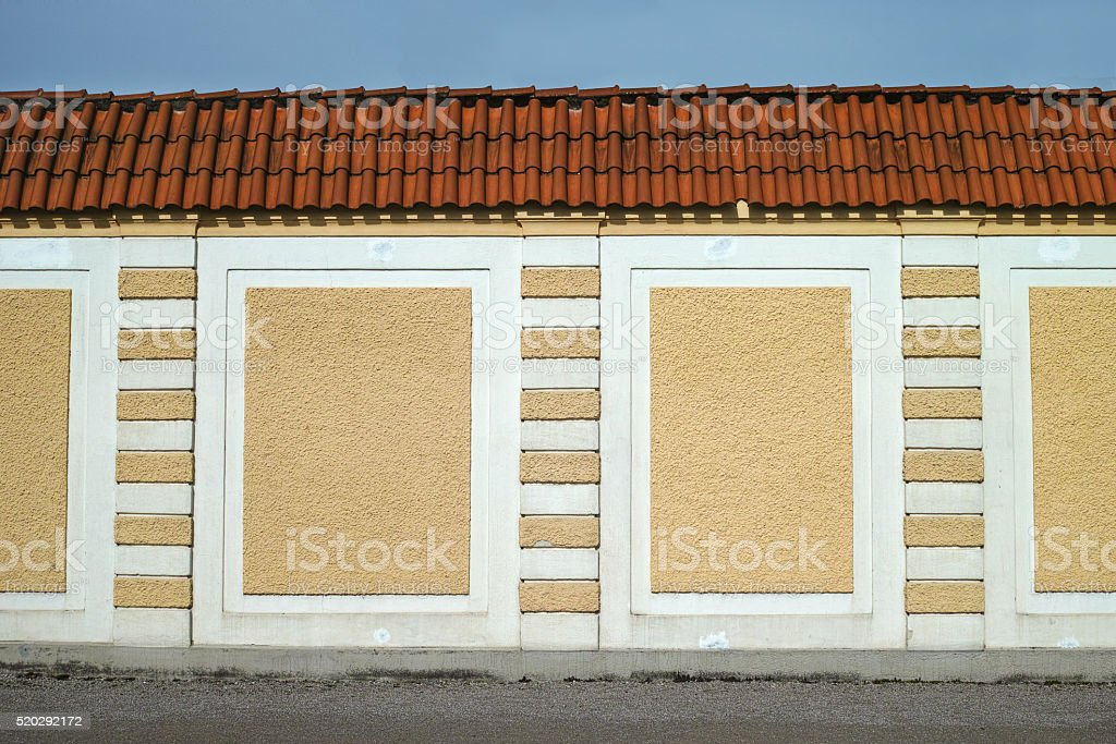 Yellow fence wall royalty-free stock photo