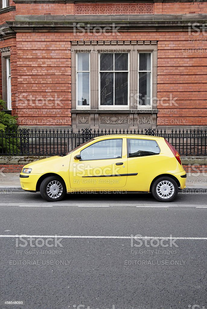 Yellow Fiat Punto car parked in Hope Street, Liverpool stock photo